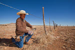 Navajo fence worker, repairing barbed wire fence on the CO Bar Ranch, north of Flagstaff, Arizona, AGPix_1983