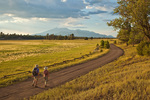 Hikers on road across Anderson Mesa near Marshall Lake with San Francisco Peaks in background, Coconino National Forest, south of Flagstaff, Arizona, AGPix_1991