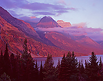 Morning clouds surround mountain peaks at Saint Mary Lake in Glacier National Park, Montana