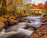 Covered bridge over the Warner River built 1840's with fall foliage