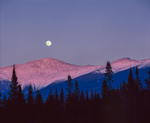 Full moon rise over snow covered Mt Washington, White Mtns National Forest