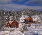 New England village in winter, with church, homes and barns after snow storm