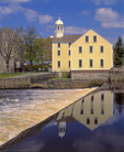 Historic Slater Mill with reflection in Blackstone River