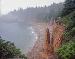 Rock formation and fog bound rocky shore line Acadia National Park