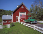 Red barn with American flag and old Chevrolet pick-up truck