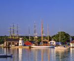 Mystic Seaport Museum, with lighthouse and reflections in Mystic River