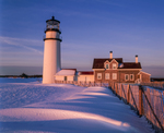 Cape Cod Light with drift fence and windblown snow patterns at first light, Cape Cod National Seashore.