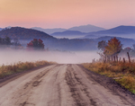Dirt road leads into foggy Black Creek Valley with views to Mt Mansfield, highest point in VT