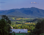 White barn, farms, village, views to Mt Mansfield, highest point in VT