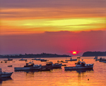 Sunrise, silhouettes of lobster fishing boats moored in Stonington harbor