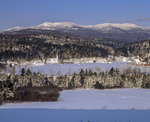 Snow covered New England village nestled at the foot of the moutains