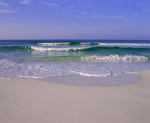 Waves breaking on beach, aqua colored  waters of the gulf coast of Florida