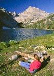 Backpacker enjoying rest at mountain lake