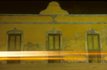 Doors on old building with passing nightime traffic in Celustun, Yucatan, Mexico