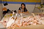 Woman at a chicken market in Otavalo Ecuador