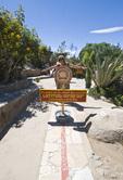 Woman stradling the equator near Quito Ecuador