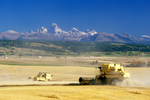 Harvesting barley in Idaho with Teton Mountains in background