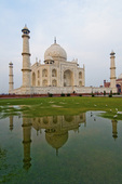 Taj Mahal reflected in flooded lawn