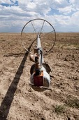 Sprinkler wheel line in dry fallow field in south-central Idaho