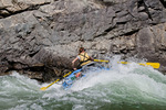 Woman rafter rowing through Upper Cliffside Rapid (class IV) on the Middle Fork of the Salmon River in the Frank Church - River of No Return Wilderness Idaho