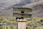 No trespassing sign on road that crosses private land blocking access to public land on Steens Mountain, OR