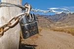 Locked gate blocking access to public land at the base of Steens Mountain Oregon