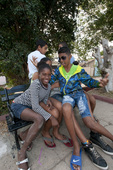Cuban teenagers hamming it up on a park bench in Trinidad Cuba