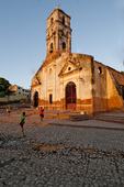 Children playing in front of ruins of Church Iglesia de Santa Anna in Trinidad Cuba;