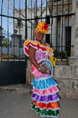 Cuban woman in traditional dress on the streets of Havana Cuba