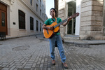 Street musician with guitar in old town Havana Cuba