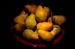 Bartlett pears in a red bowl still-life