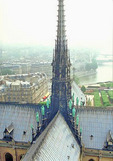 View from atop Notre Dame:  Beyond is the Seine - a silver ribbon flowing beneath a chain of bridges in the morning mist.