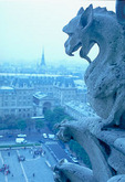 "A ghostly figure of a ""chimera,"" or mythical monster, peers over Paris from atop Notre Dame  Cathedral."