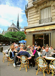 Cafe-goers bask in the spring sunshine in this brasserie behind Notre Dame.