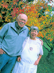 Don and Sally Schmitt - during a break from Sally's fall cooking class - outside fruit trees belonging to their Bates & Schmitt Apple Farm at Philo, in Anderson Valley wine country.