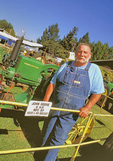Skip Harris - proud owner of antique tractor - at the Mendocino County Fair & Apple Show, in Boonville.
