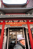 The former Chinese Telephone Exchange, now the Bank of Canton, rises in three pagoda-like tiers, on Grant Avenue, in Chinatown.