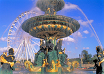 Fountain at Place de la Concorde, with the Ferris Wheel behind it.