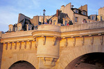 Pont Neuf's rounded arches each have a keystone carved with humorous faces.