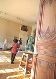 A woman walks among the sculptures in the 18C Hotel Biron, an elegant setting for Rodin's sculptures.