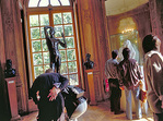 Visitors admiring the Rodin sculptures in the 18C Hotel Biron.