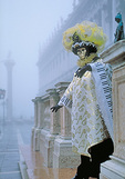 Winter mists in San Marco Square and a Venetian in costume suggest a time when Casanova himself walked the streets.