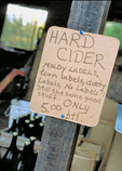 Sign advertising hard cider for sale at Apple Farm's self-service stand at Philo, an organic farm in the heart of Anderson Valley wine country.