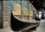 Ancient gondola in the Venice Naval Museum, in the Ship Pavilion room, originally an oar workshop for the Arsenale, the naval shipyard that could turn out an entire galley in 24 hours when Venice was a major maritime power.