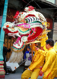 A Chinese dragon, symbol of strength and good fortune, helps