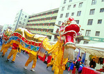 A dragon dances through Chinatown during the Chinese New Year festivities.