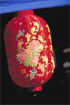 This red paper lantern, in Chinatown during Chinese New Year, represents the tradition of hanging lamps to symbolize the light and warmth of spring.