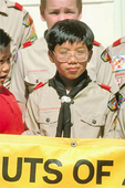 A Chinese-American Boy Scout poses for a picture with other Boy Scouts of Troop #3 in San Francisco's Chinatown.  Troop #3 is the first Chinese-American troop of Boy Scouts of America, one of the oldest in the United States.