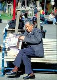 An elderly Chinese-American gentleman reads the Sunday newspaper in Portsmouth Square, the larger of Chinatown's two green spaces in San Francisco's Chinatown.