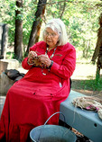 Julia Parker weaves a basket at the Indian cultural village, among the pines in the park.  She is an expert in several Native basketry traditions, including her own Pomo traditions and traditions of her husband's people, the Sierra Miwok.  Her work is in the permanent collection of the Smithsonian and the private collection of the Queen of England.